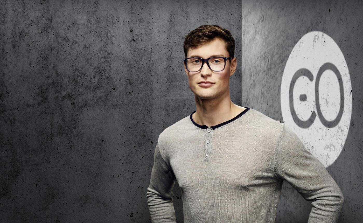 Male model wearing men's carrera glasses