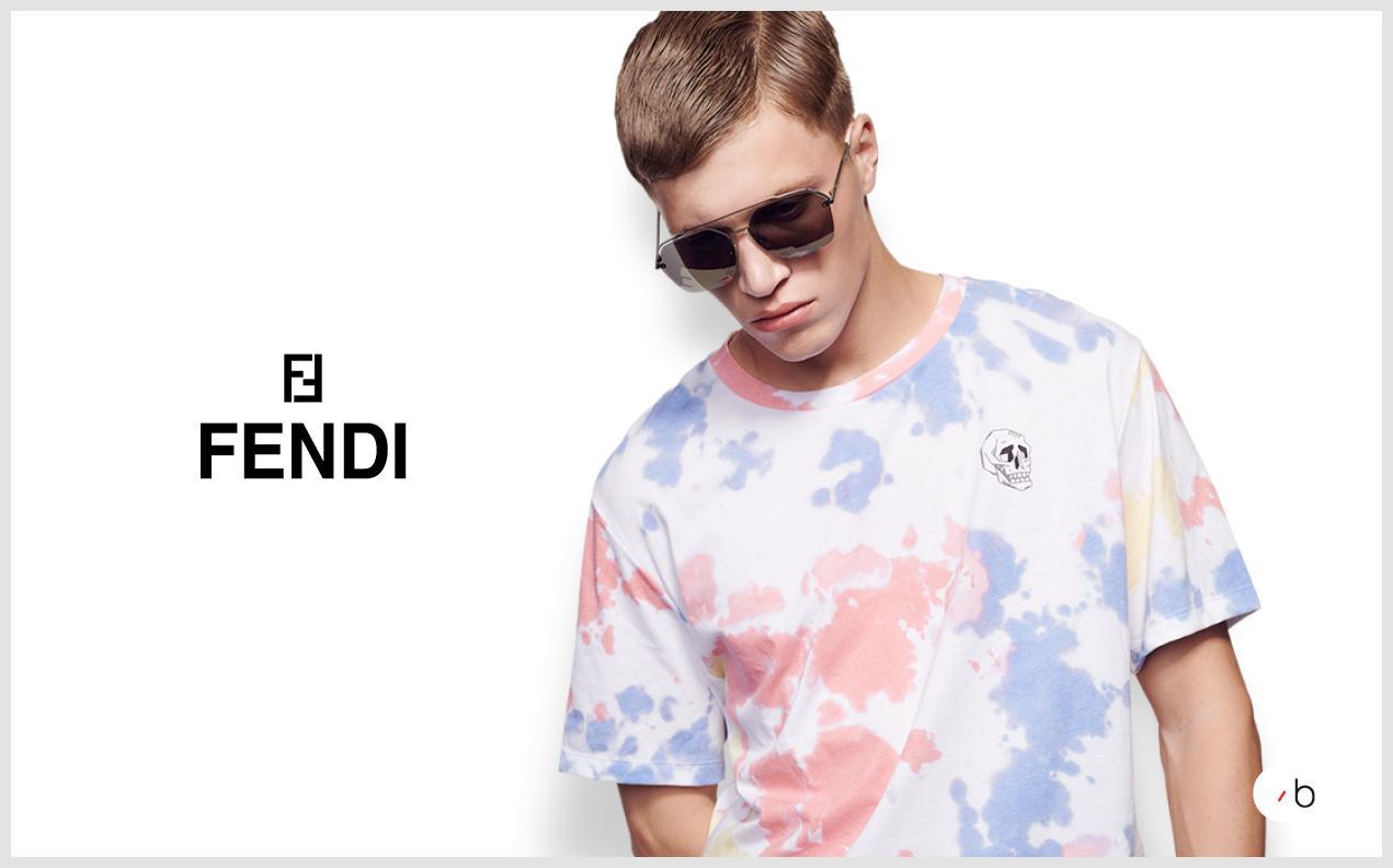 Male model wearing black Fendi sunglasses